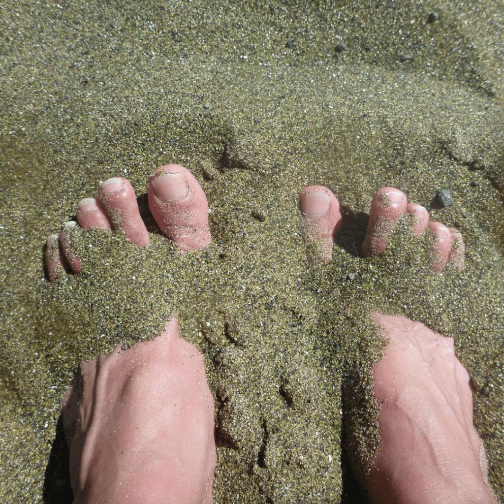 Bury your toes in the green sand of Papakōlea Beach on Hawaii Island