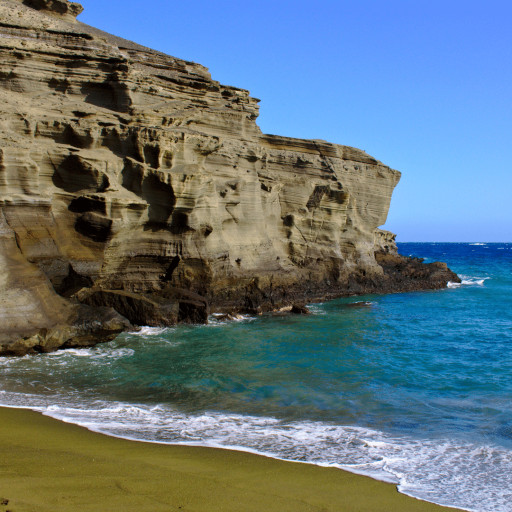 If you enjoy hiking and love nature, you definitely don't want to miss Papakōlea Beach, Hawaii Island's green sand beach.